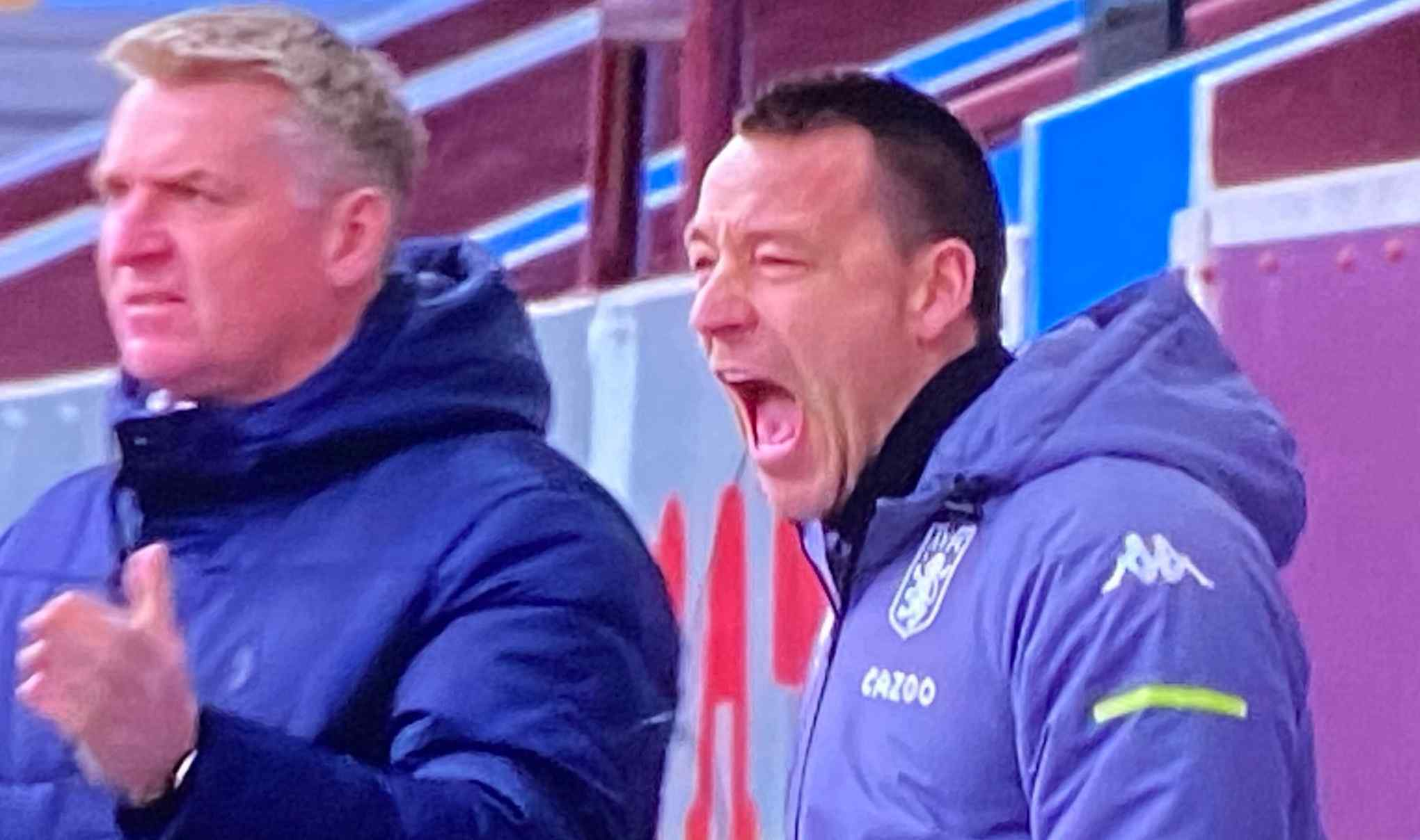 John Terry reacts to Aston Villa's 1-0 victory over Arsenal with celebratory post
