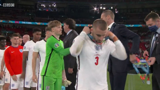 England players remove runners-up medals after Euro 2020 final defeat to Italy